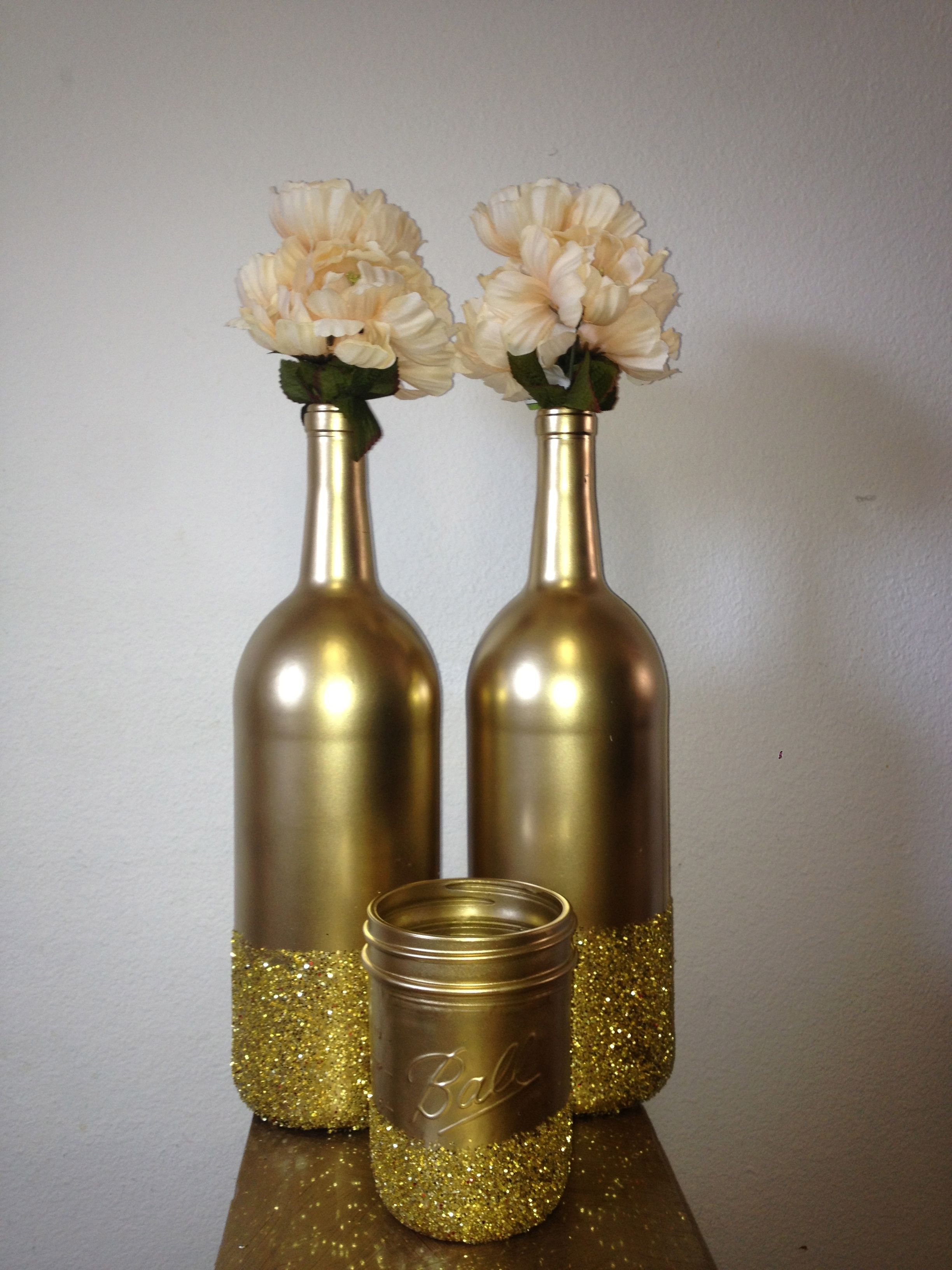 spray painted wine bottles and mason jars for decoration