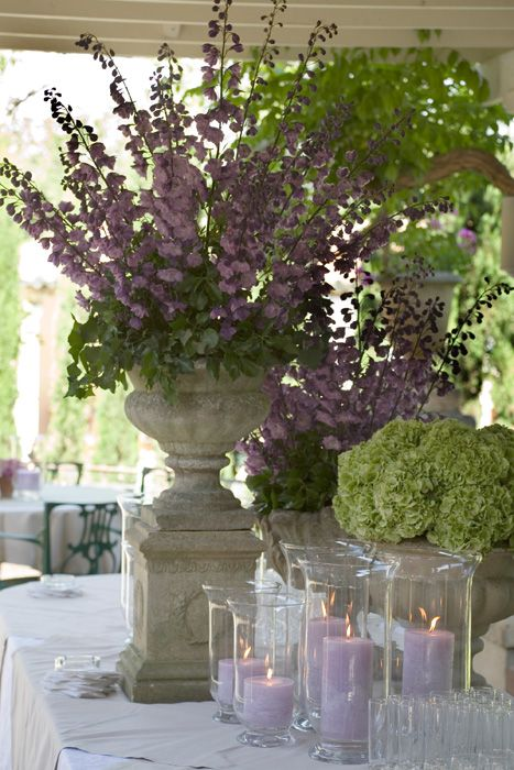 Large Centerpieces In Purple And Lime Green Fill The Massive Space Large Floral Arrangements Wedding Flowers Wedding Venue Decorations