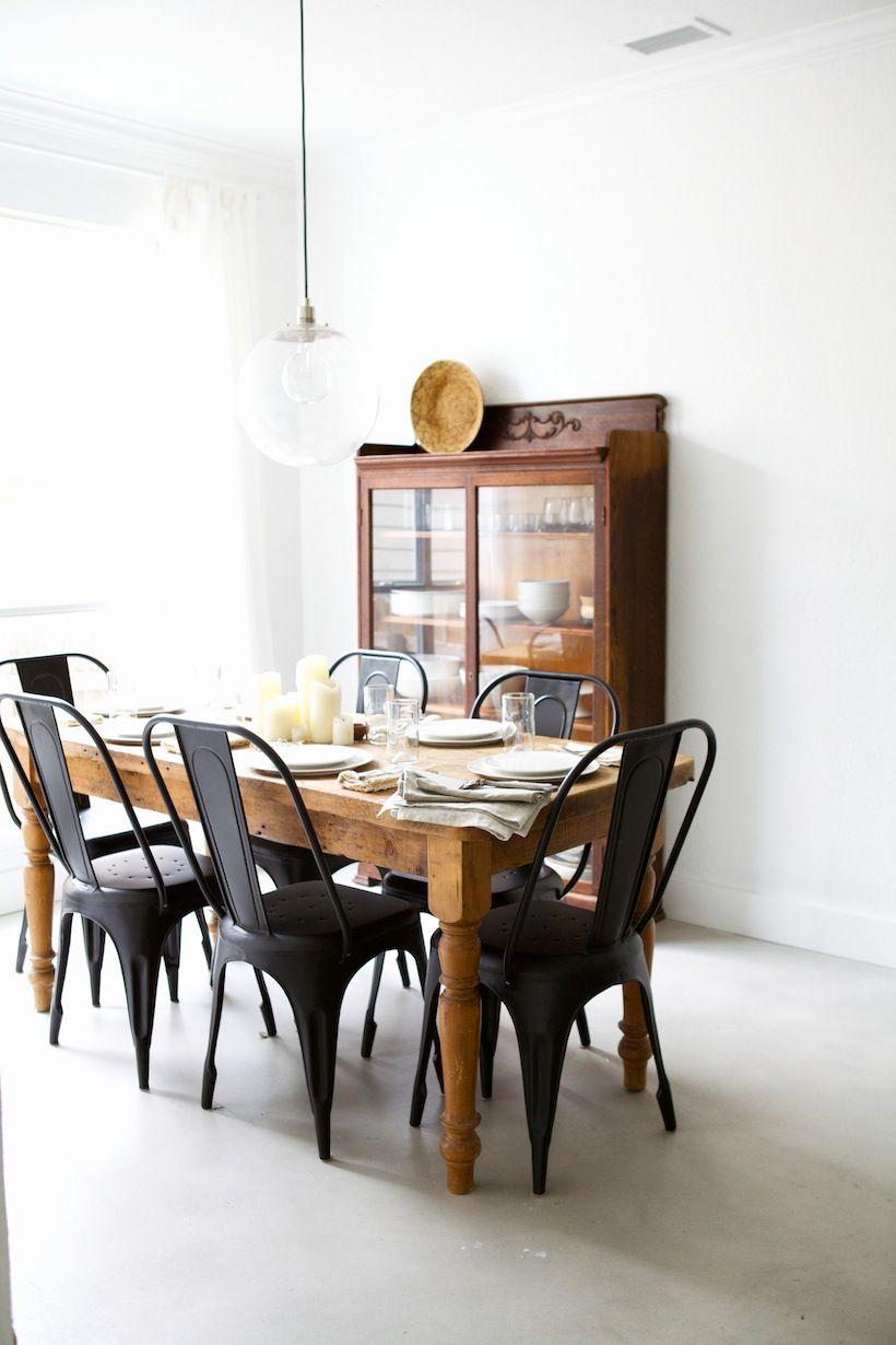 Wood Dining Table With Black Mod Plastic Chairs