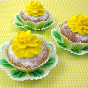 Too pretty to eat cupcakes with royal icing yellow flower zinnias and springy muffin cups by http://www.fancyflors.com!