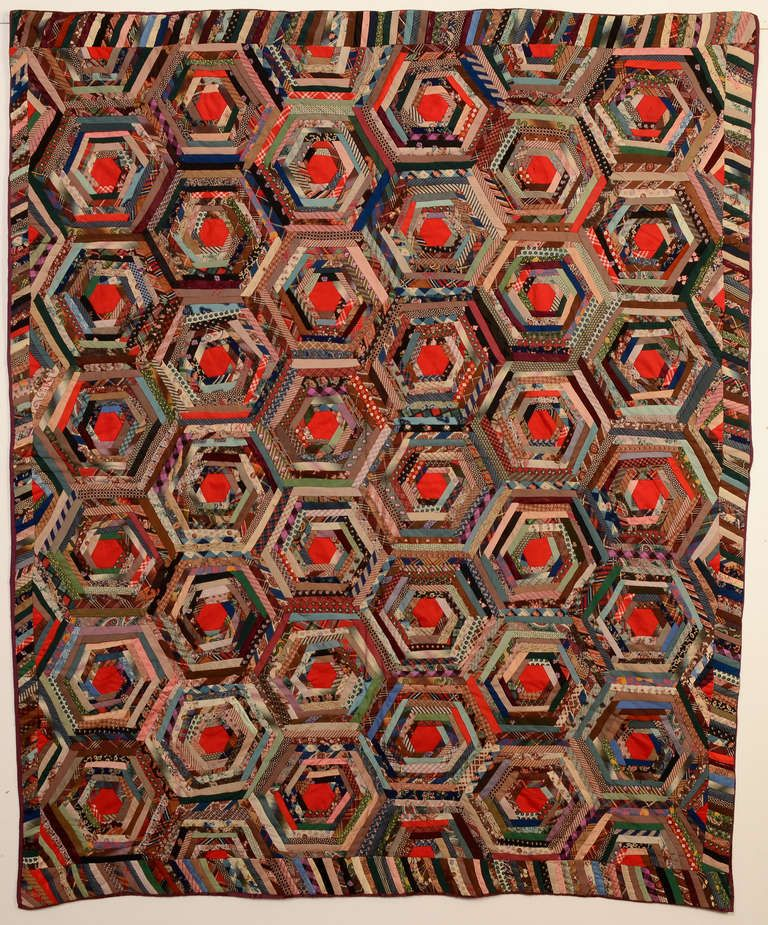 Log Cabin forming a rare spiderweb pattern. Made of a large variety of wool chal...