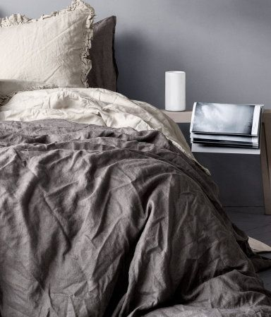 Duvet cover set in washed linen with double-stitched seams at edges.  Fastens at foot end with concealed metal snap