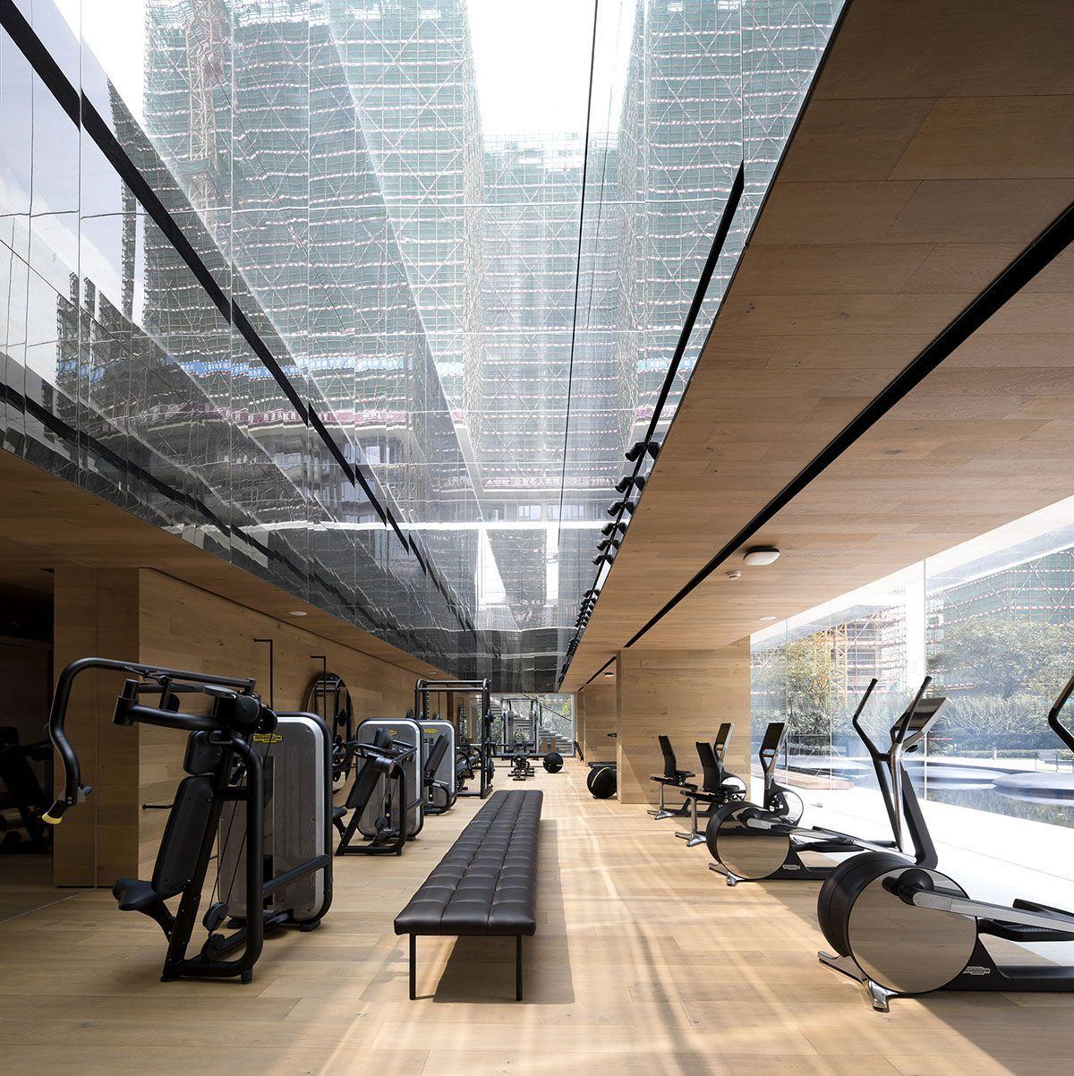 Luxury Gym In China Embraces Sleek And Minimal Design Curbed In 2020 Luxury Gym Minimal Design Design