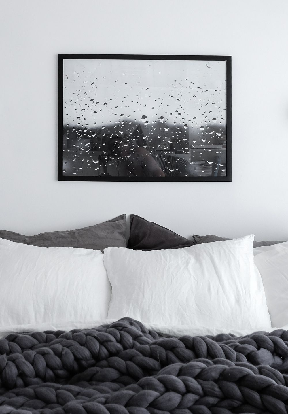 Scandinavian grey bedroom with raindrops print and chunky wool