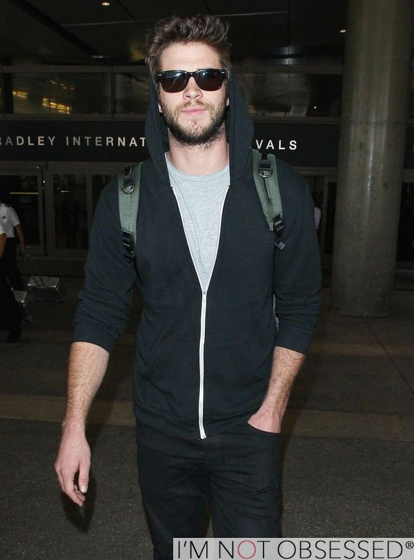 LIAM HEMSWORTH 'Hunger Games' Star Touches Down At LAX