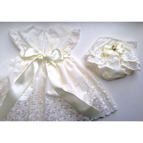 This stunning dress comes in either pure white or ivory scalloped hem broderie anglaise fabric and fully lined in a matching cotton with a netted underskirt for extra fullness and double satin ribbon. This dress has little flutter sleeves with matching broderie anglaise lace. It also zips at the back. This dress comes with a matching nappy cover with frills and bows or flowers. The legs and waist is elasticated. The nappy cover can be made from matching coloured cotton or satin. Please let…