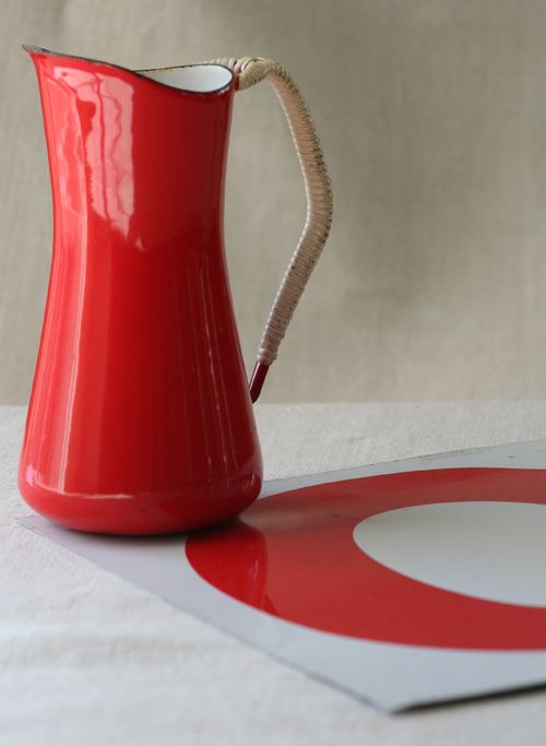 red enamel pitcher with woven handle