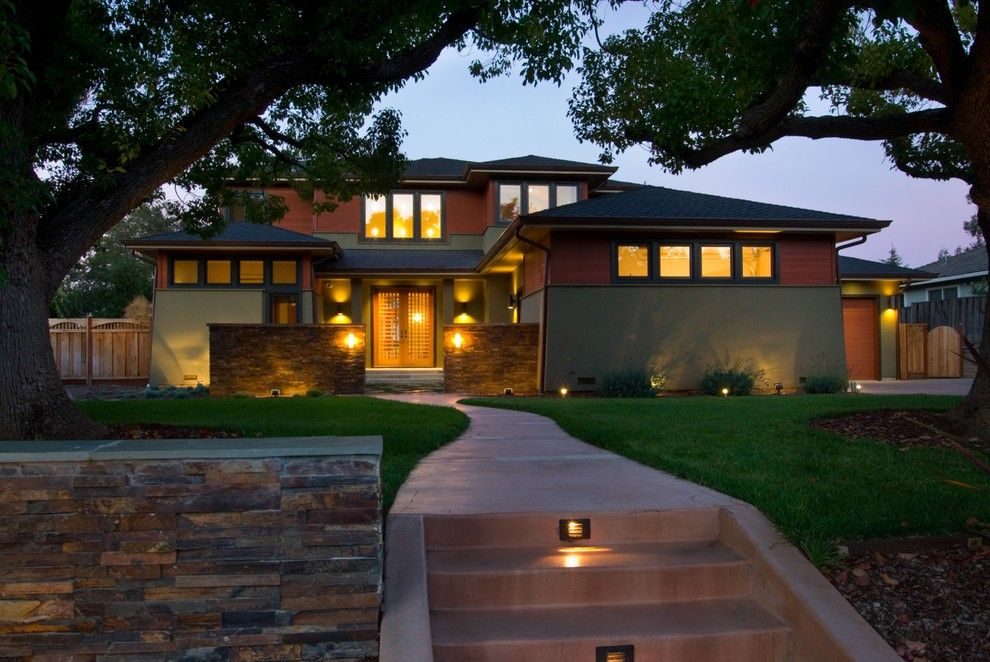 This new Prairie style home in California features hip roofs, casement  windows tight to the