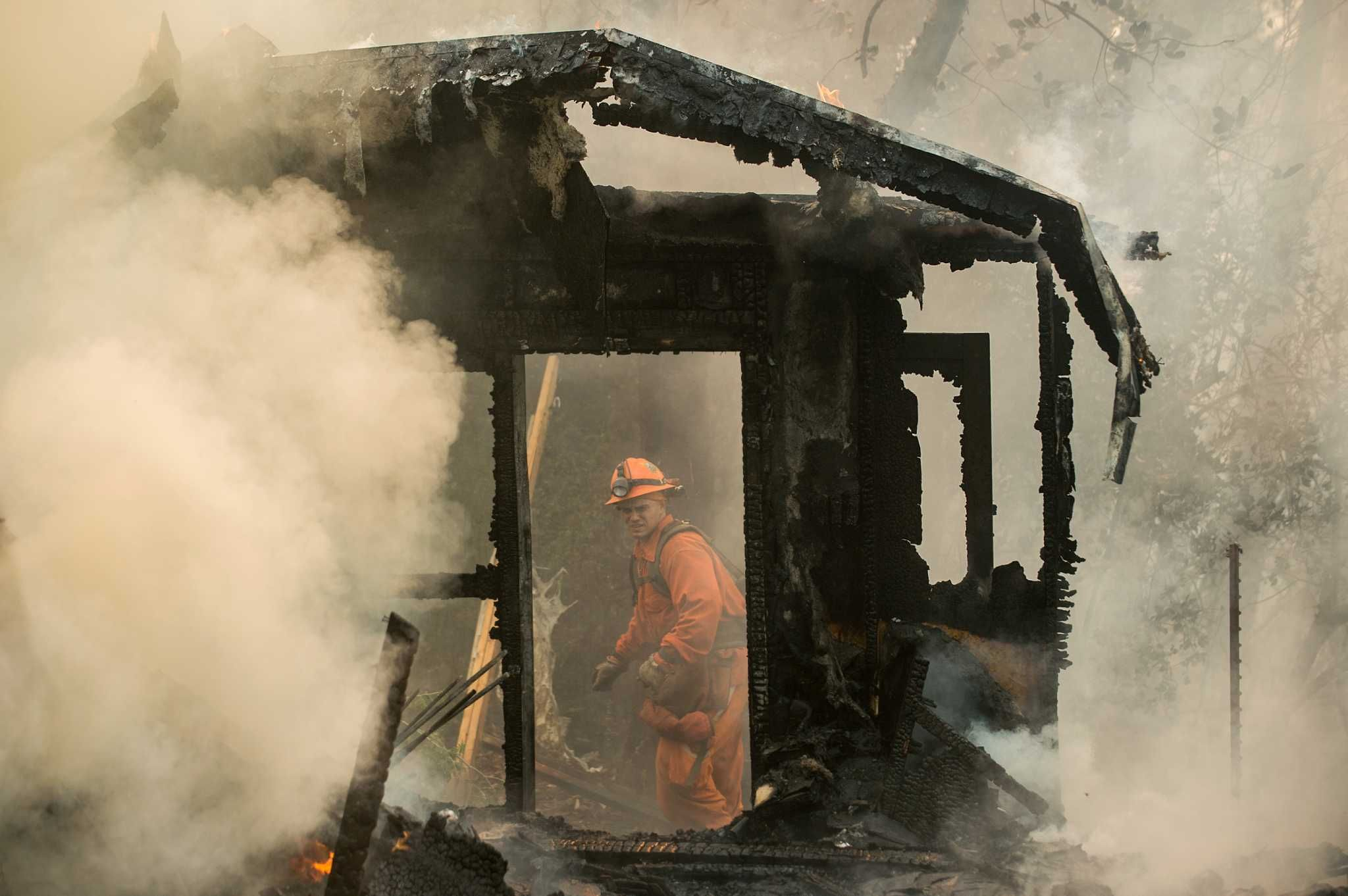 (AP) — Some evacuations were lifted as cooler weather gave