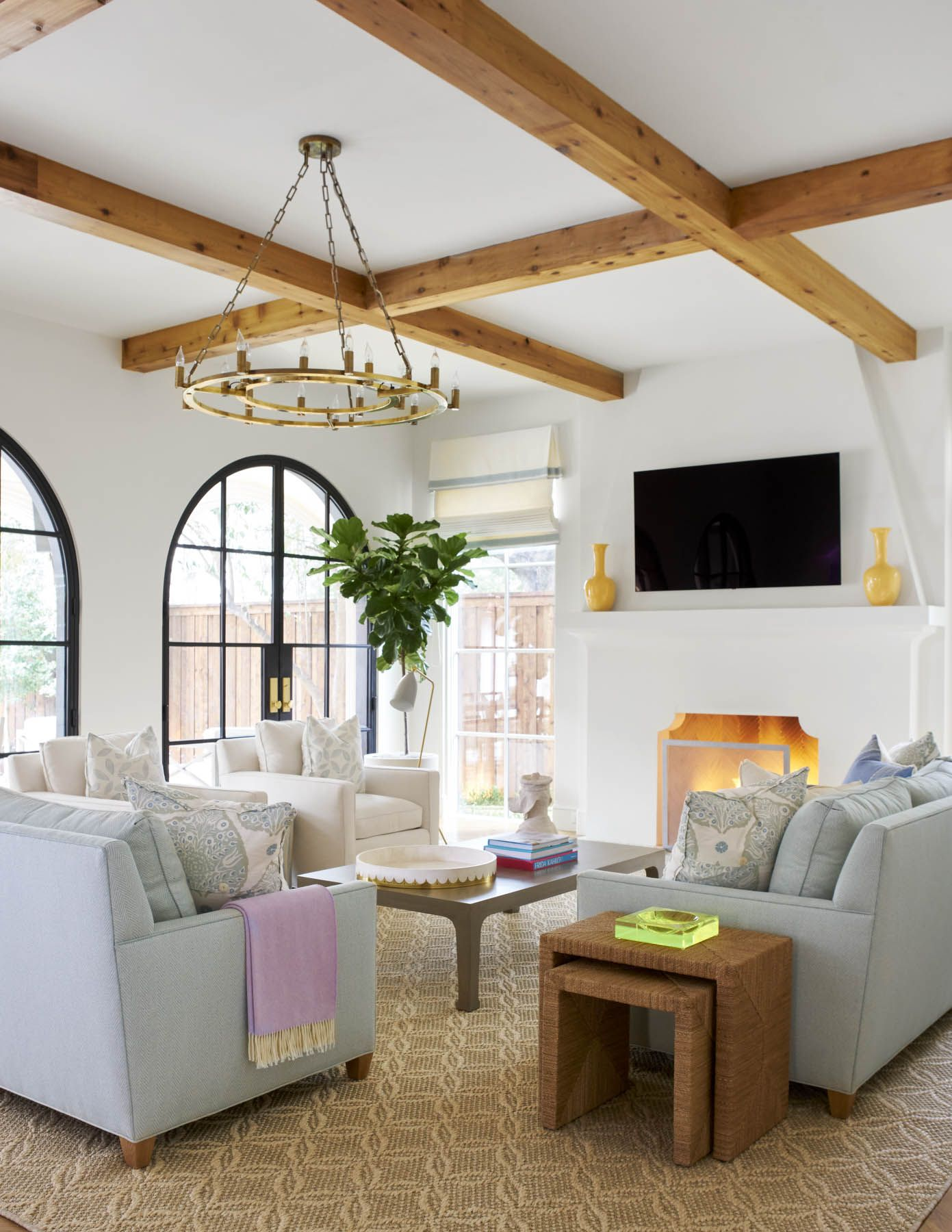 A modern Tuscany-style living room with warm wooden exposed beams ...