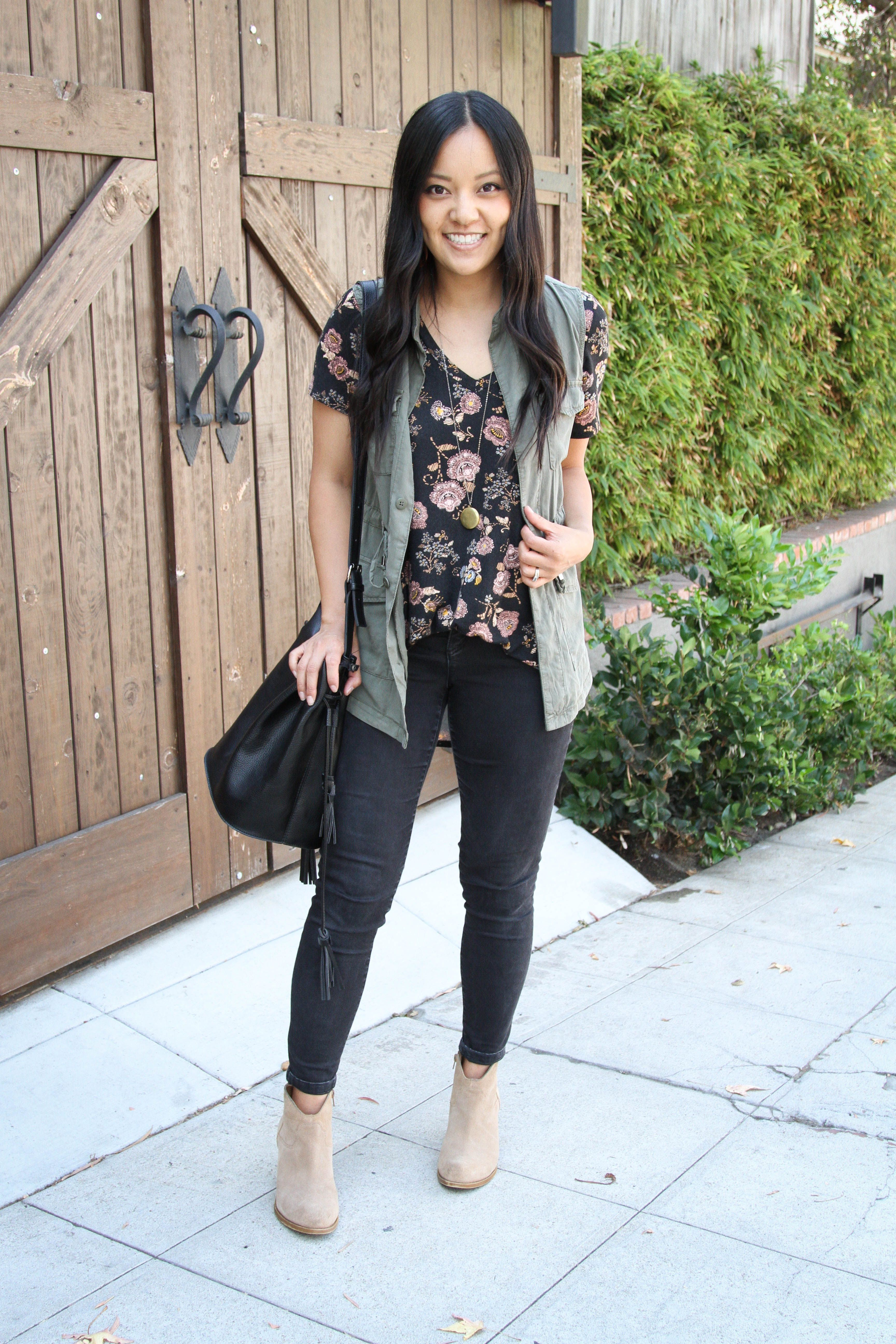 5 Ways To Wear A Utility Vest Tips For Finding One Floral Top Outfit Black Jeans Outfit Spring Everyday Casual Outfits [ 5184 x 3456 Pixel ]