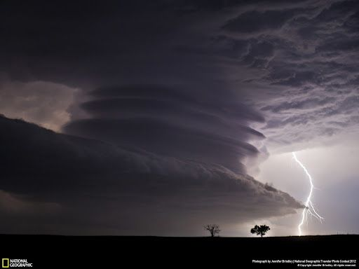 National Geographic ~ Photo Contest 2012 ~ Stacked Supercell with Lightning ~ Photo and caption by Jennifer Brindley ~ This huge mesocyclone supercell was near the Nebraska / Kansas border on the night of June 22nd, 2012. What a stunning structure!