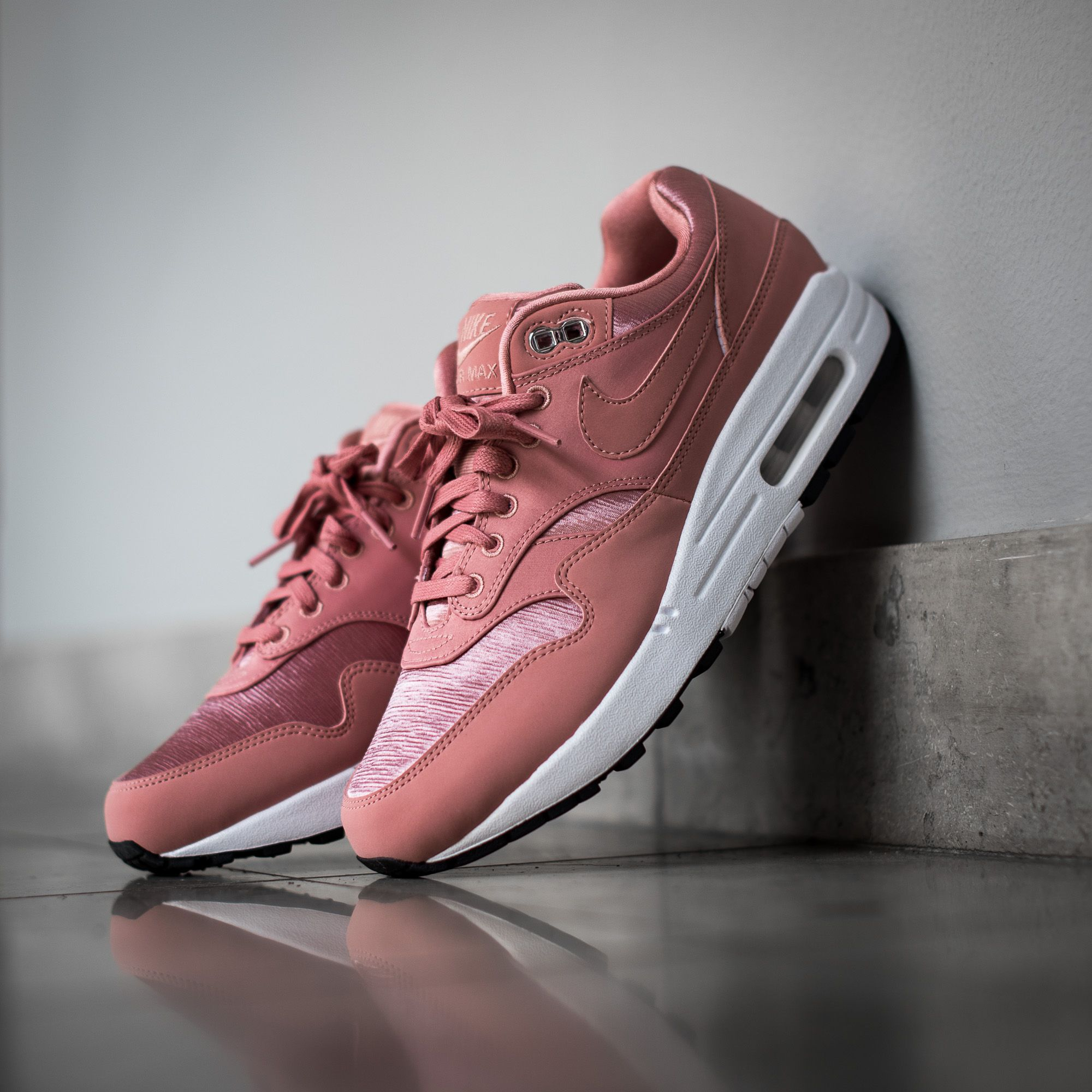 quality design 9c04c cbe43 store the nike air max 1 se is for women in a rust pink white colorway