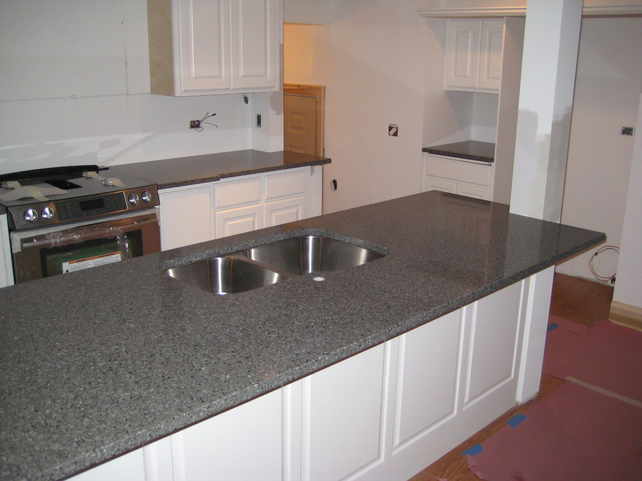 Color Balckburn Quartz Fabricated And Installed By Art Granite