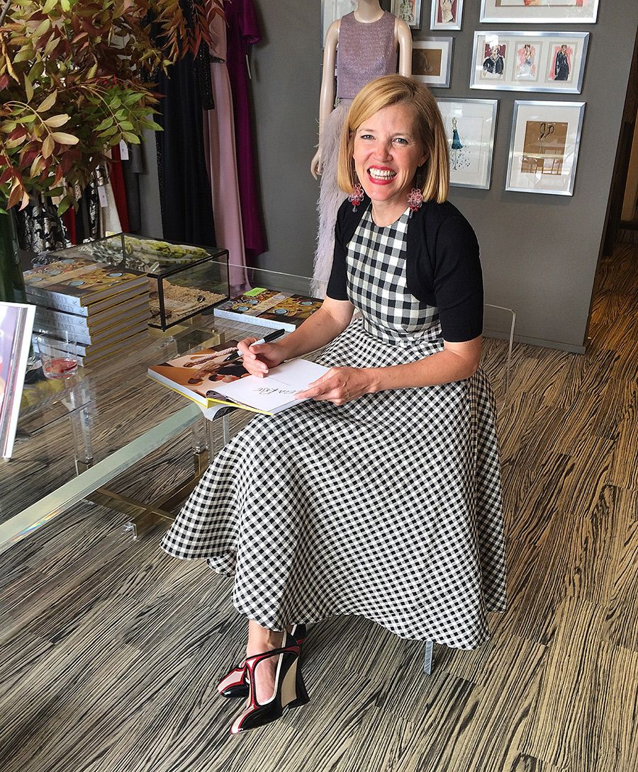 """Follow the NYC-based, Texas-bred designer as she travels to Dallas to promote her new book, """"Prêt-à-Party: Great Ideas for Good Times and Creative Entertaining."""" Here Lela Rose signs copies of her book at her boutique in Highland Park Village."""
