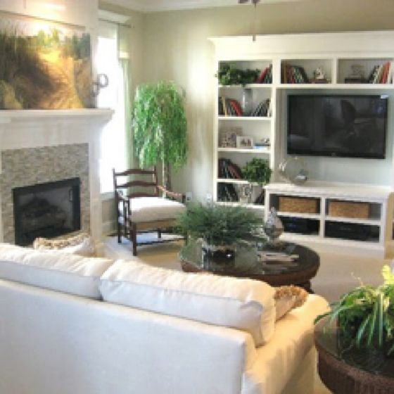 Wall Of Built Ins Around The Mounted Tv Small Living Room