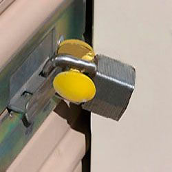 The Padlock Guard Securing A Roll Up Storage Shed Door Shed