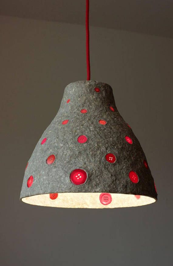 Paper mache pendant light with red buttons
