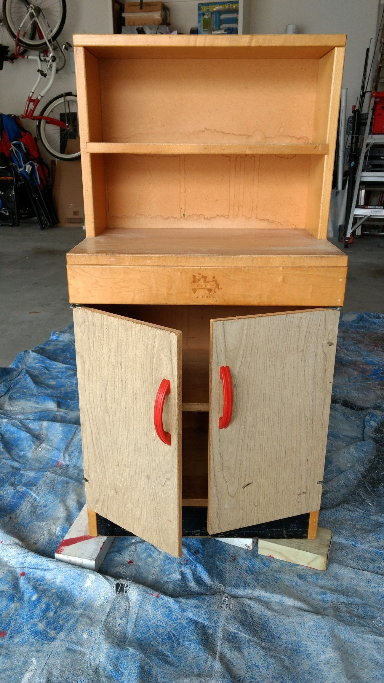 Before, solid wood child's play cupboard from a church or