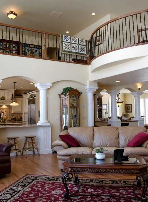Living Room Balcony Design: A Graceful Staircase And Balcony With Wrought Iron