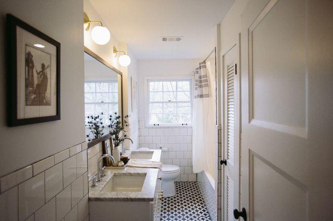 White tile on the walls balanced with fun floor tiles midcentury