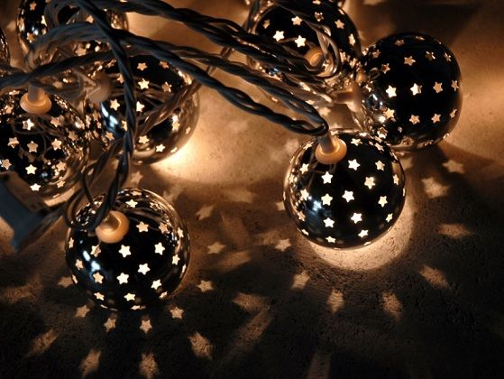Cool dark globe string lights with star cutouts Backyard ideas