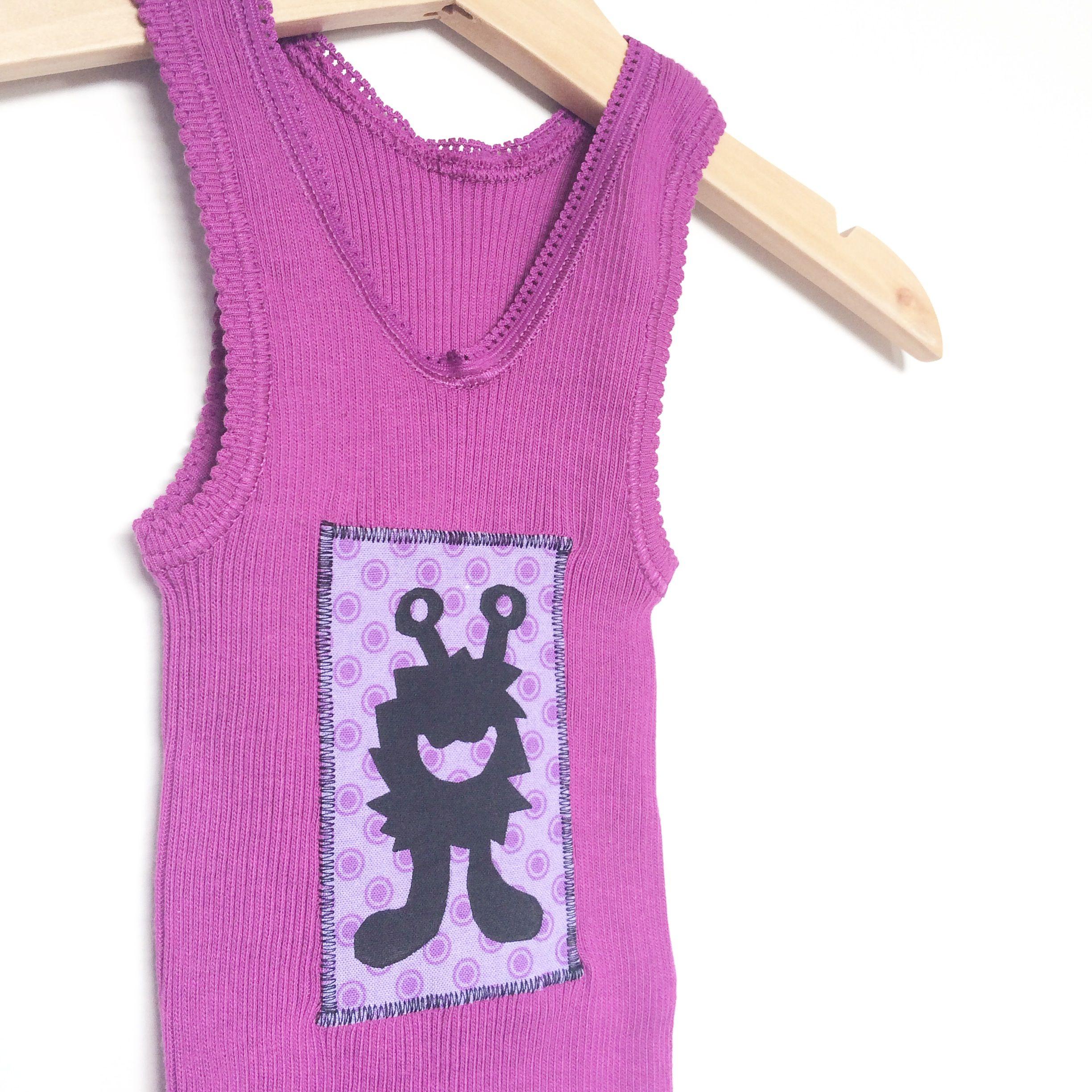 Screenprinted Purple Monster Singlet. Size 0. Polka Dot