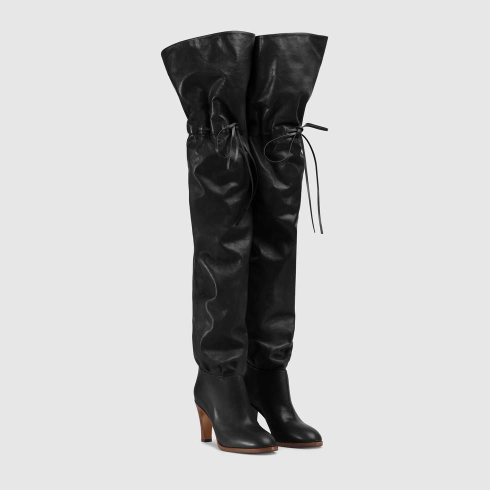12e956128cc Shop the Leather over-the-knee boot by Gucci. First introduced as a ...