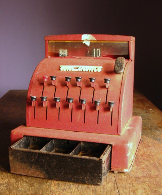 Vintage Red Toy Cash Register  Mine was new and shinny and one of my most favorite toys as I marked up everything with a marker in moms house...:)