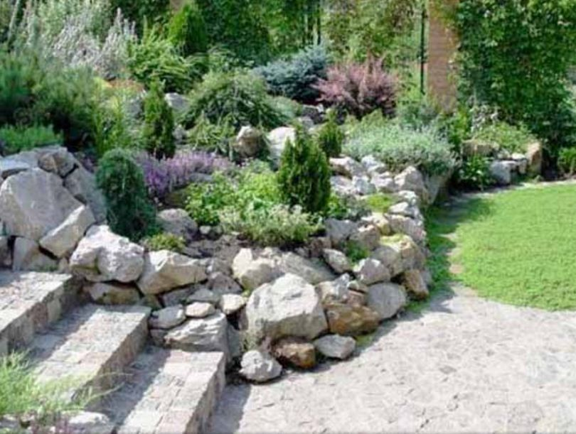 beautiful rock garden design with natural stone wall adds nice enclosure to the stairs an enables raised flowers christopher alexander pattern