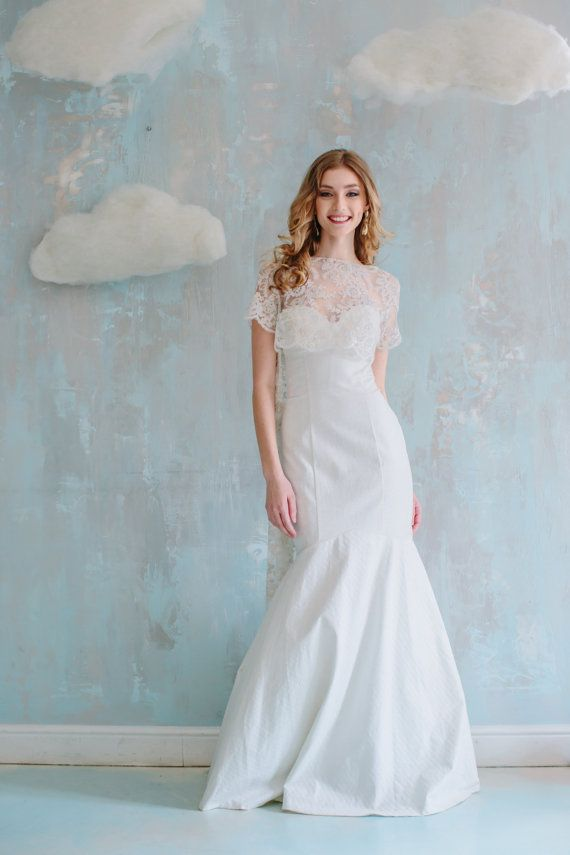Elegant wedding dress highlights the natural beauty of a bride. Its ...