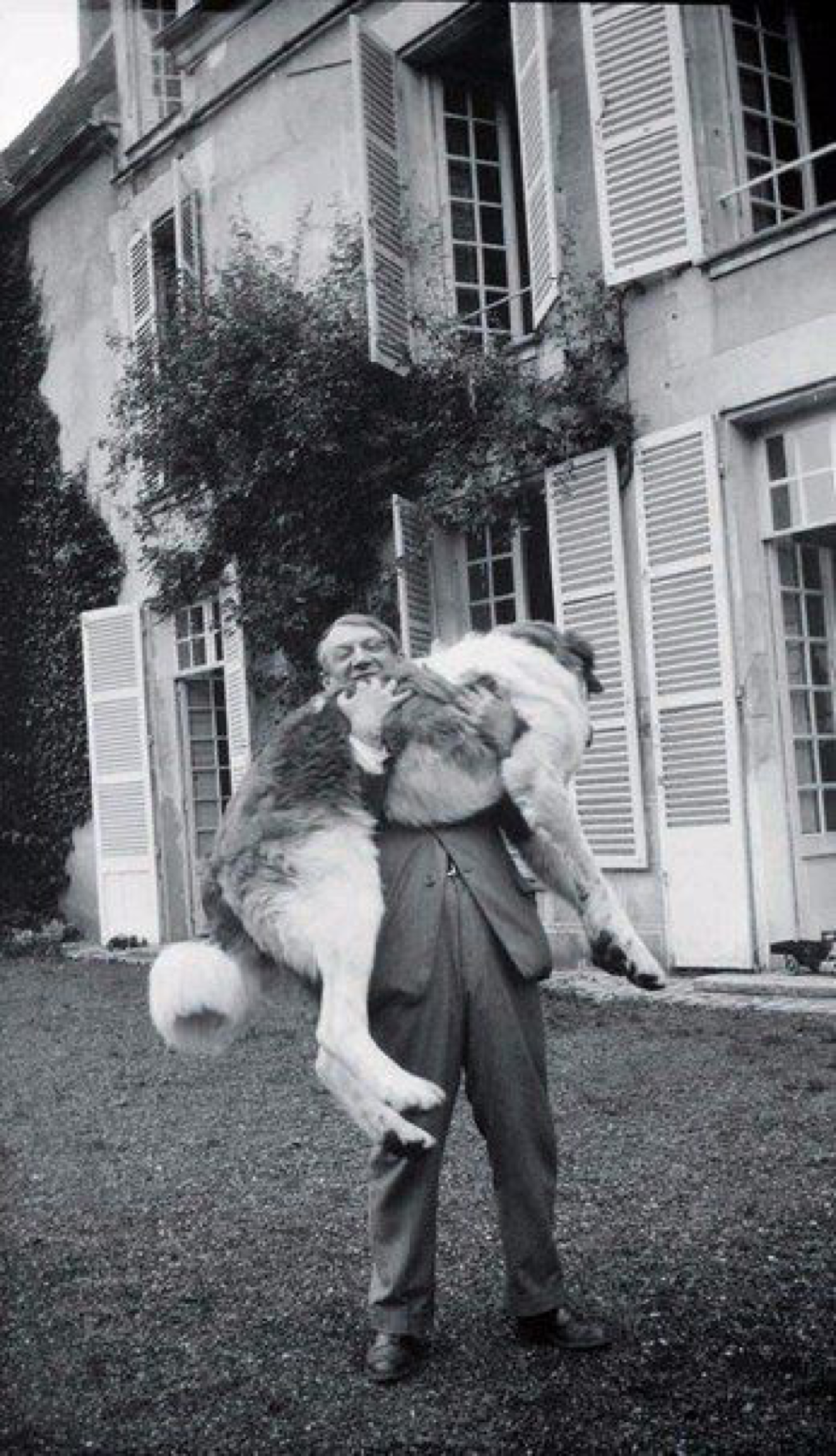 Pablo Picasso with his dog Bob, France, 1932