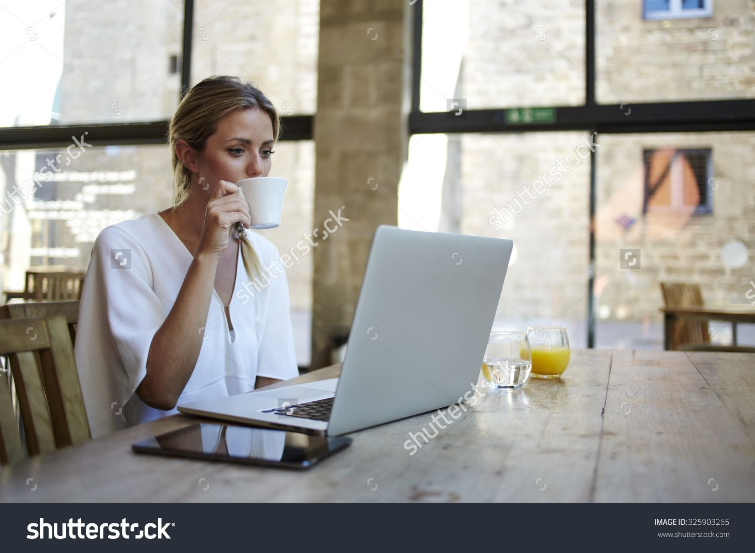 Portrait of a young beautiful businesswomen enjoying