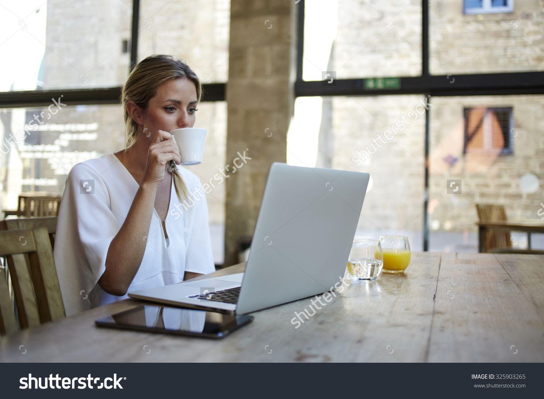 portrait of a young beautiful businesswomen enjoying