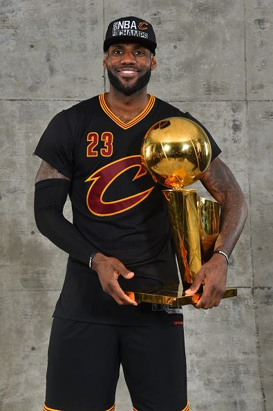 LeBron James Of The Cleveland Cavaliers Poses For A Portrait With World Championship Trophy After Winning NBA Against Golden