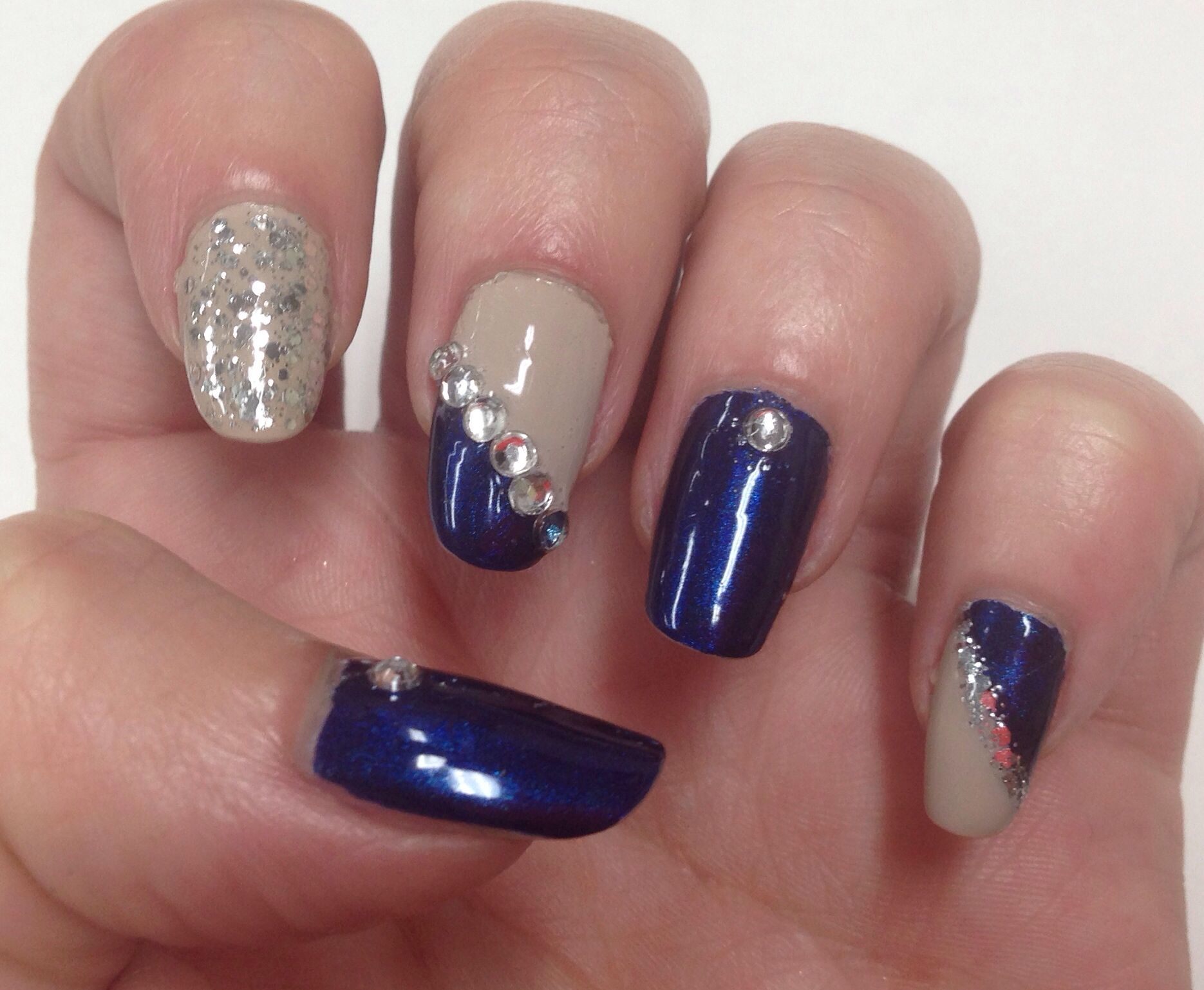 Navy blue and nude nails with silver glitter and diamanté accents ...
