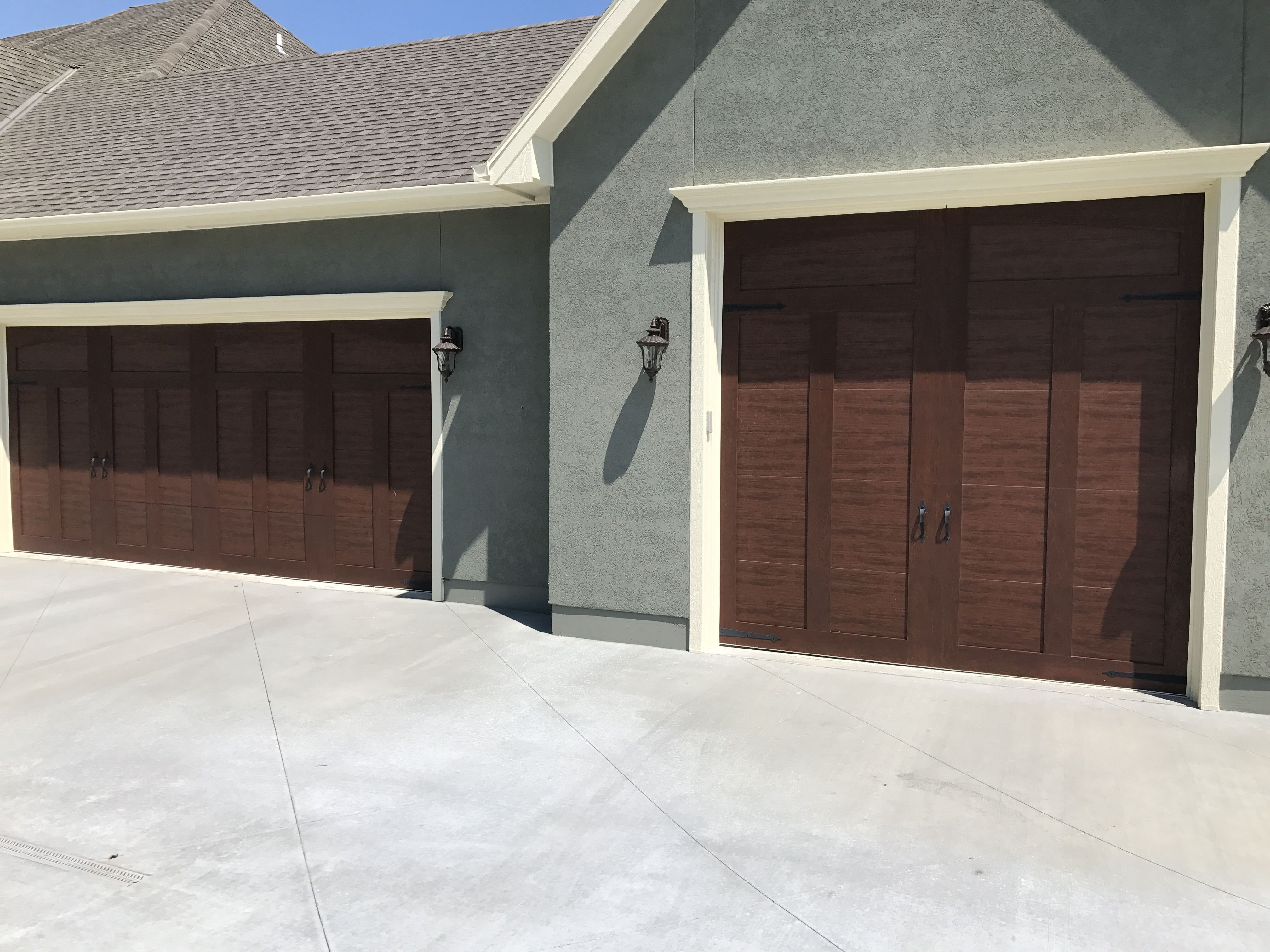 Two Heavy Duty Carriage Court Mahogany Stained Garage Doors With