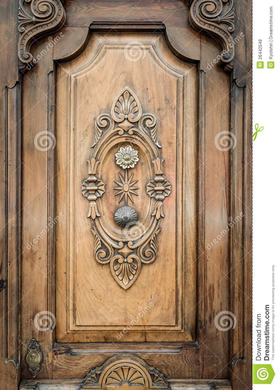 Old Door Of Wood With Patterns Carved On It Royalty Free Stock