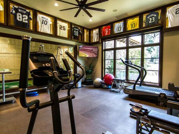 Sports themed home gym with ample space  Seems to have more decoration than  equipment. Sports themed home gym with ample space  Seems to have more