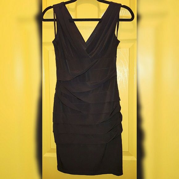 Black Carole Little Dress Black Carole Little Dress. Size 6. Great Condition. No Rips, No Fade, No Stains.  Feel Free To Ask Questions, Additional Photos, Or Measurements Carole Little Dresses
