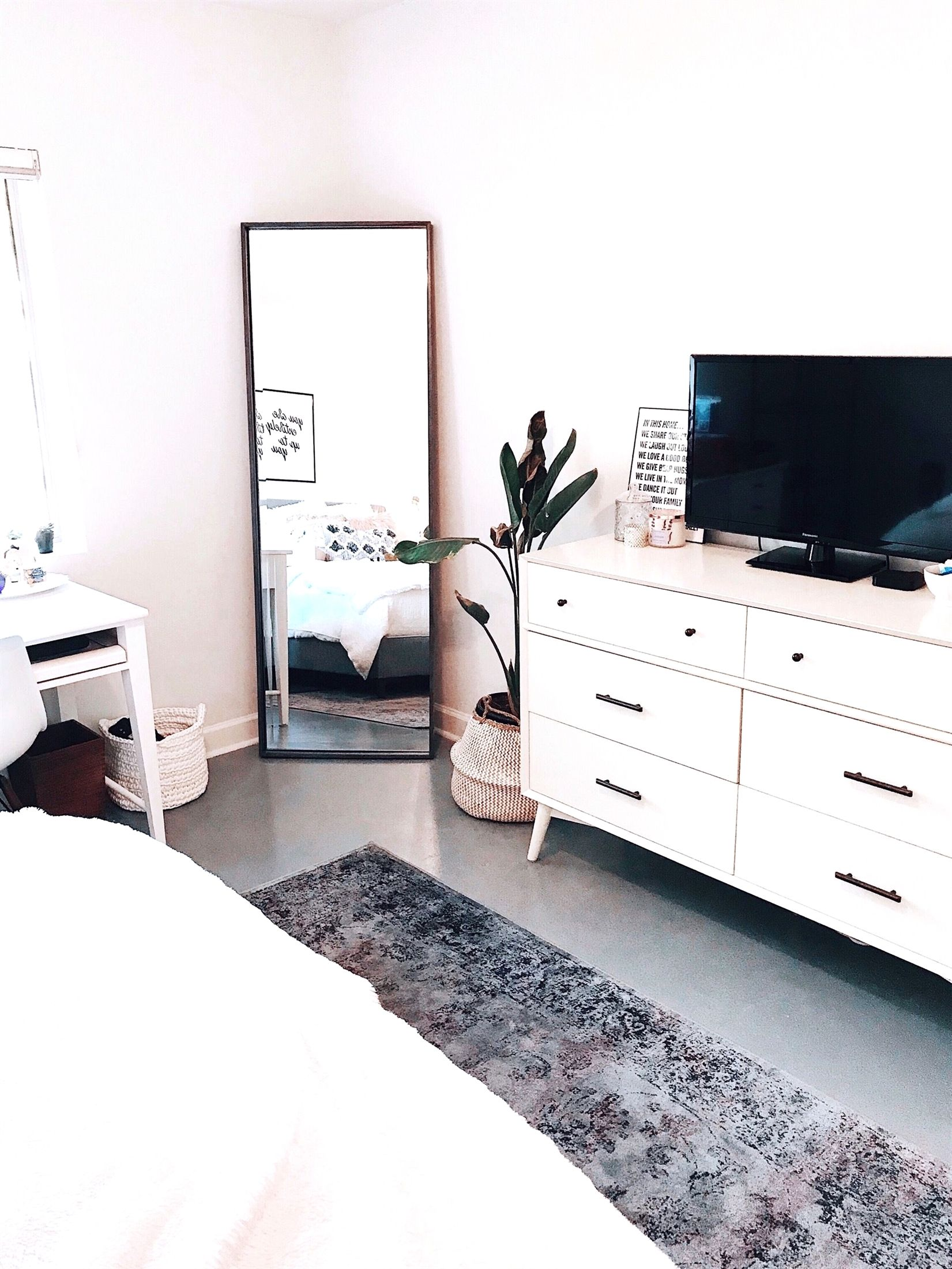 Clean aesthetic bedroom | @blairewilson fresh, bedroom, white, minimal, plant, room makeover, full length mirror, area rug, tv, aesthetic, home, inspo, inspiration, goals, style, cozy, loft style, blaire wilson room, blaire wilson bedroom, all white, boho, modern, blogger, organized, tidy, urban outfitters, living spaces, home good, amazon, #bedroom ideas #bedroomgoals