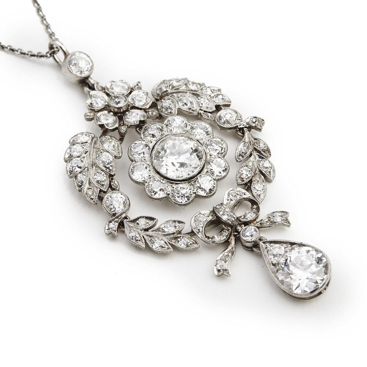 A belle epoque diamond pendant set with numerous old and singlecut