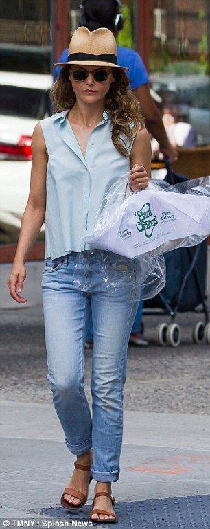 She showed off her toned arms in a lightweight sleeveless shirt teamed with cropped blue jeans