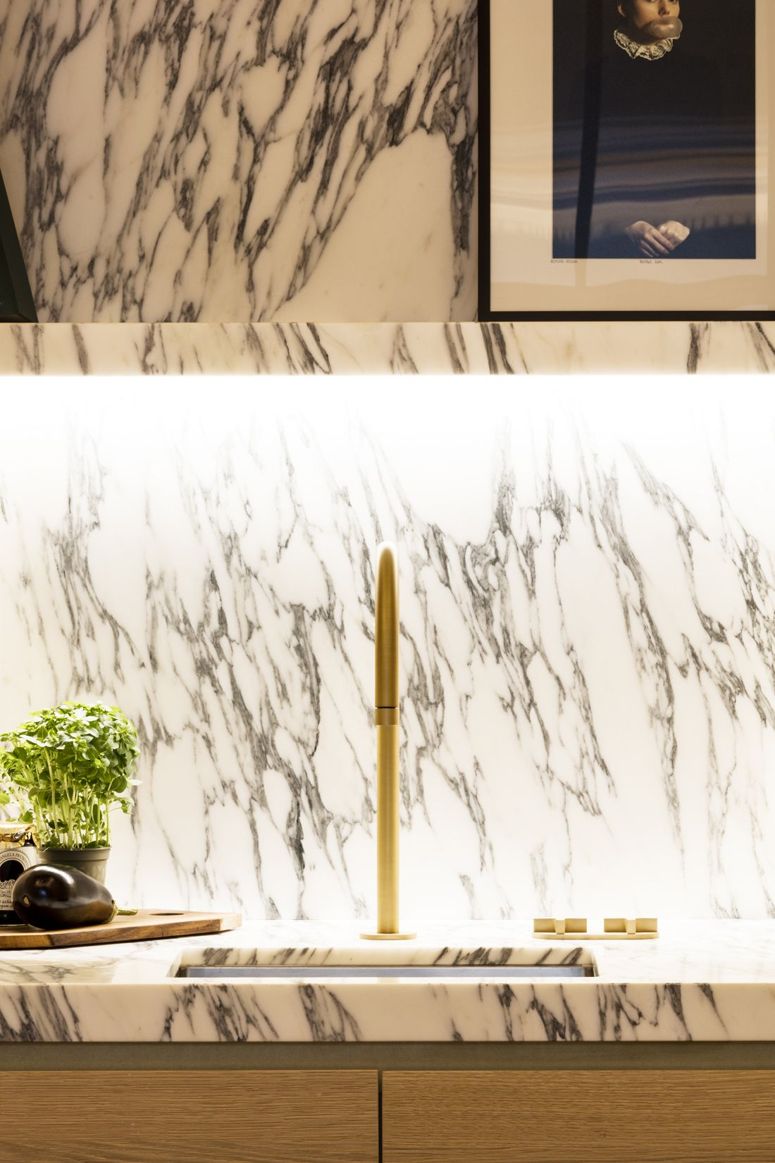 A Dramatically Marbled Stone Backsplash by Obumex | Kitchen ...