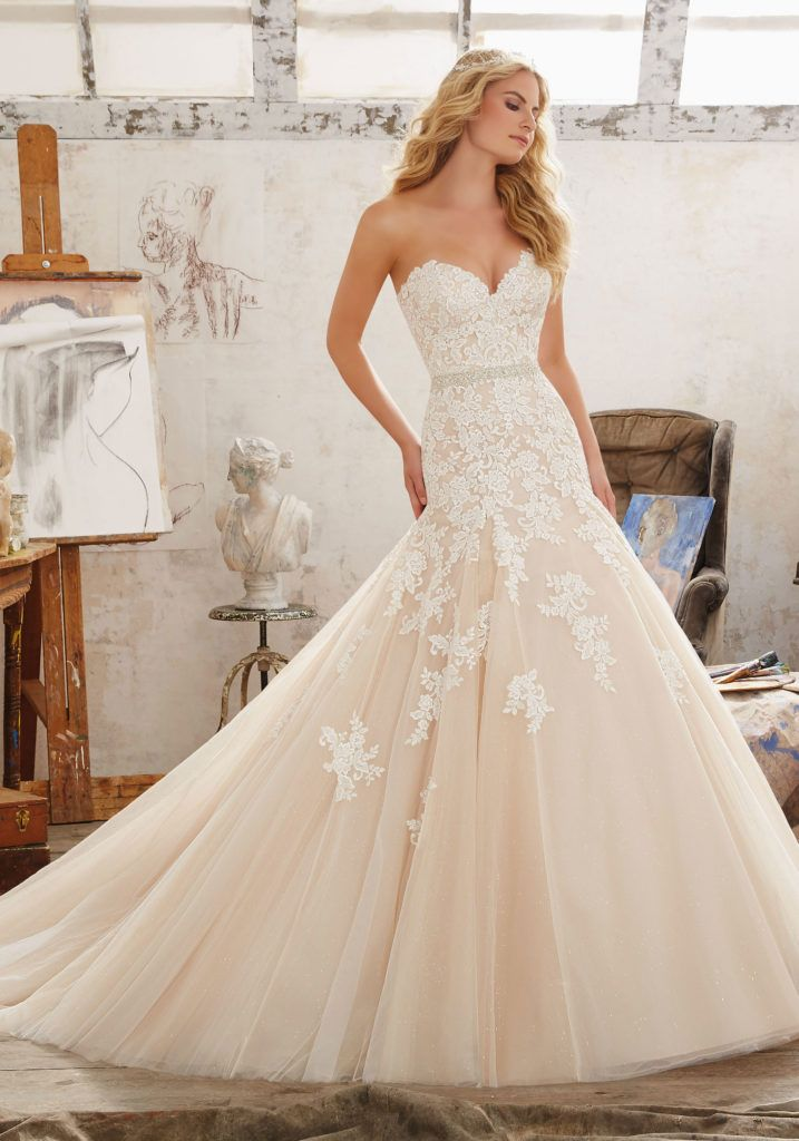 Wedding Dresses and Bridal Gowns by Morilee. Beautiful Fit & Flare Bridal Gown with Sweetheart Neckline Embroidery on Tulle and Net.