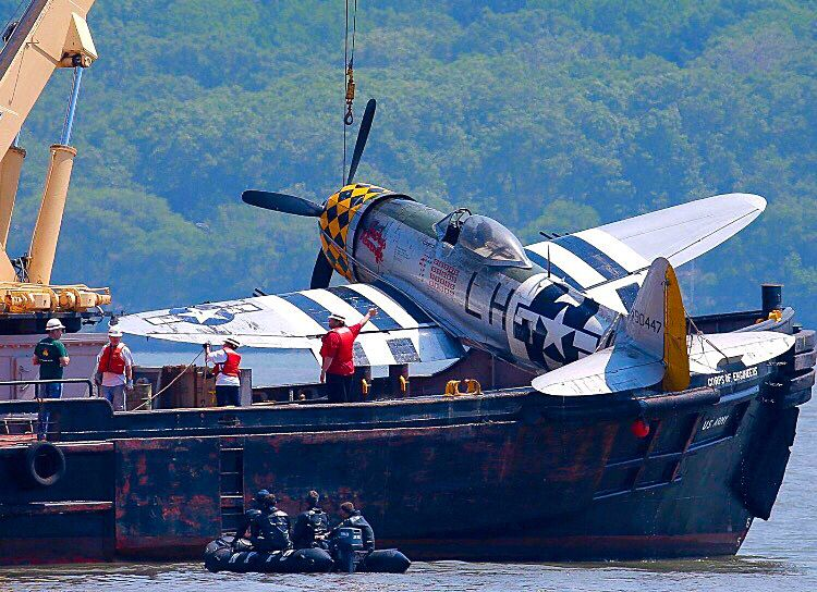 A crashed Republic P47D Thunderbolt is recovered from the