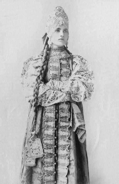 Young Woman wearing a traditional russian dress from her province - Central Russia, Province of Nizhniy Novgorod.