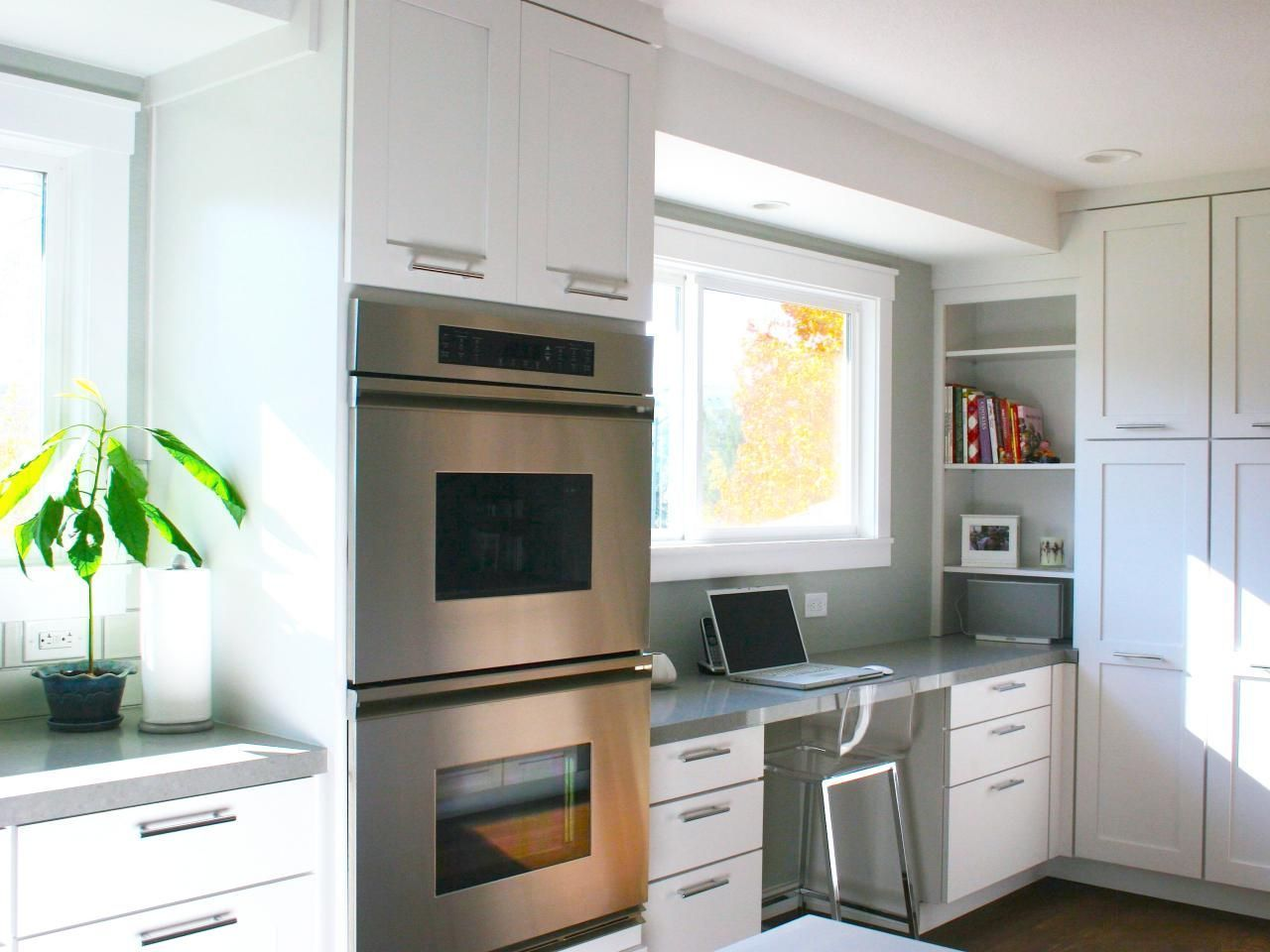 In this contemporary kitchen a builtin desk positioned on top of