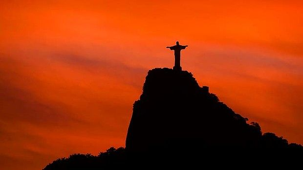 Spectacular: Christ the Redeemer at sunset.   Christ the ...