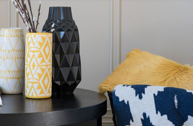 The rustic Edie Vase adds a subtle hint of strong colour to an interior. Handmade from earthenware, its geometric white and yellow pattern is the perfect pop of texture you need. Due to this product being individually handmade each vase may vary in appearance slightly.